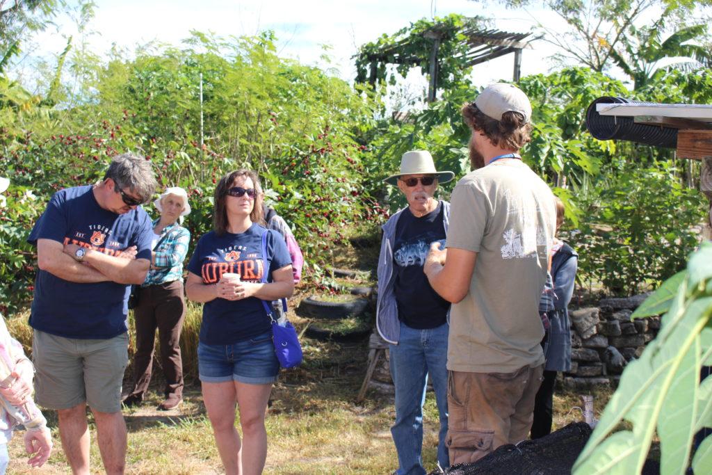 Josh Jamison gives a tour to Garden Celebration attendees.